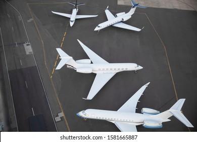 Unbranded aeroplanes waiting on runway
