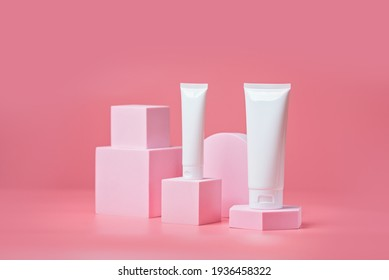 Unbranded blank cosmetics packages on a pedestal. Skincare female products advertising