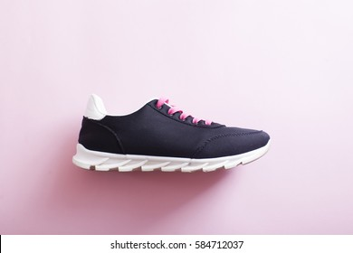 Unbranded running shoe, sneaker or trainer. Pair of sport shoes outdoors. Toning.Women's athletic shoes. fitness, sport, training, people and lifestyle concept.