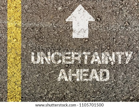 Uncertainty ahead, written on road surface