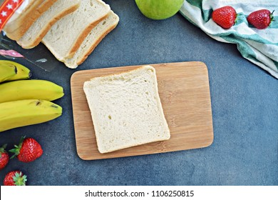 Uncoated toast on a wooden board
