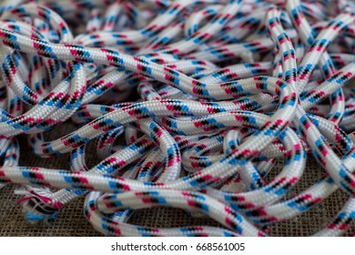 Uncoiled striped rope. Close-up.