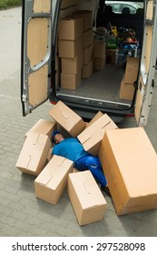 Unconscious Male Worker Lying On Street Surrounded With Boxes