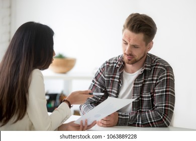 Unconvinced skeptical client looking doubtful about rejecting deal listening to manager, uncertain distrustful investor not impressed with offer of business partner at meeting suspecting fraud