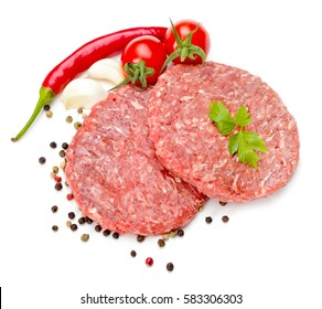Uncooked beef hamburger meat on white with pepper seeds