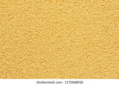 uncooked dry couscous background. Food texture. Top view