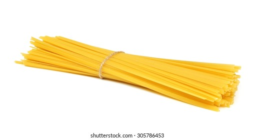 Uncooked dry fettuccine pasta tied in a bundle isolated on a white background