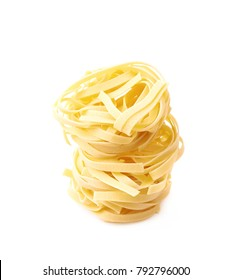 Uncooked fettuccine pasta ball isolated over the white background