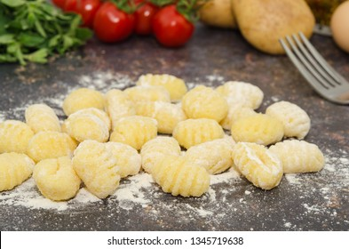 Uncooked fresh homemade gnocchi. Italian cuisine - raw gnocchi, made of potato, flour and egg.