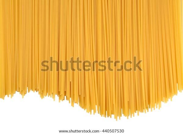 Uncooked Italian pasta spaghetti on a white background