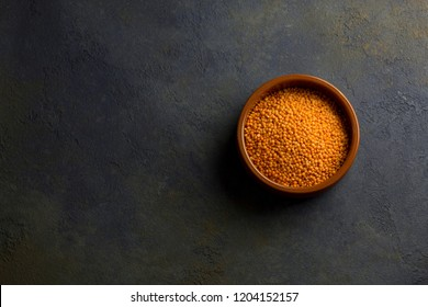 uncooked lentils on a dark background