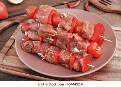 Uncooked Marinated And Rubbed Shish Kebabs From Pork Tenderloin On Skewers Ready For Grilling In BBQ