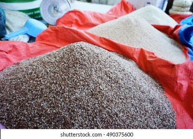 Uncooked medium-grain Bhutanese red rice being sold inside a market.