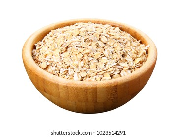 Uncooked oat flakes in wooden bowl on white background. Healthy food. Close up, top view, copy cpace, high resolution product