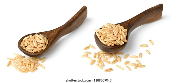 uncooked oats in the wooden spoon, isolated on white