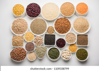 Uncooked pulses,grains and seeds in White bowls over white background. selective focus