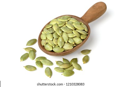 uncooked pumpkin seeds in the wooden spoon, isolated on the white background