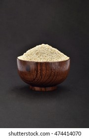 Uncooked Rice In Wooden Bowl With Dark Background