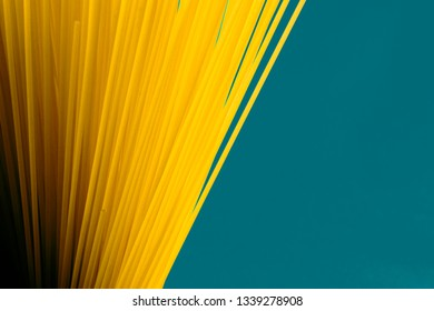 Uncooked Spaghetti with Blue-green background