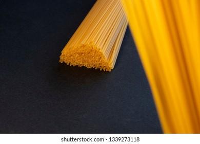 Uncooked Spaghetti on a Dark Background