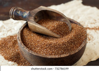 Uncooked teff grain in a bowl close up