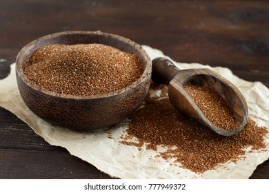 Uncooked teff grain in a bowl with a spoon close up