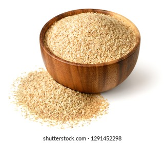 uncooked wheat germ in the wooden bowl, isolated on the white background