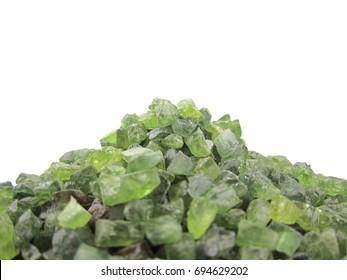 Uncut green peridot gemstone,rough,isolated on white background