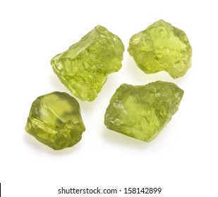 Uncut natural green peridot gems isolated on white background.