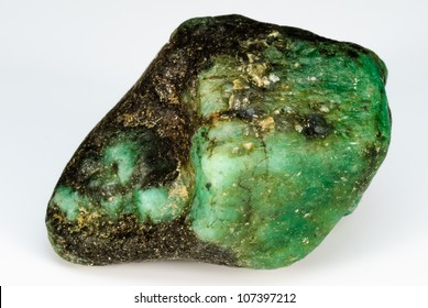 Uncut and raw Emerald crystal.  This natural Emerald still has host rock present.