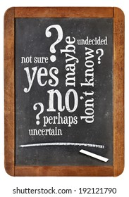 undecided concept - yes, no, maybe  word cloud on a vintage blackboard