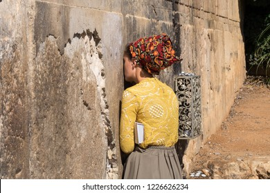 Undefined religious jewish woman pray next to Cave of Machpelah in Hebron or Tomb of the Patriarchs. Israel