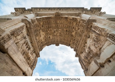 Under the Arch of Titus at The Roman Forum in Rome, Italy