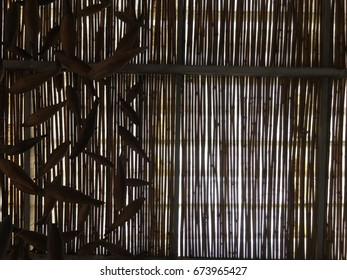 under bamboo stick roof with afternoon sun