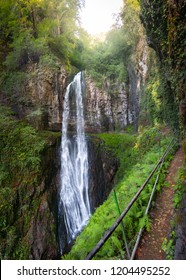 under big jungle waterfall Giant Velikan tropical landscape with ferns of Abkhazia. Vertical