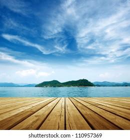 Under the blue sky,platform beside sea .