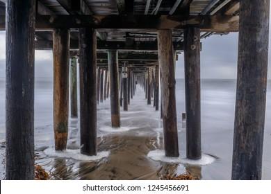 Under Capitola Wharf at Dusk. Capitola, Santa Cruz County, California, USA.