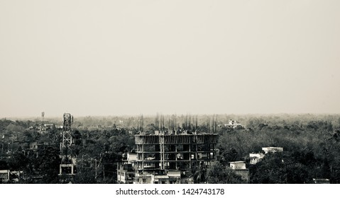 Under construction building around an urban area black and white photo