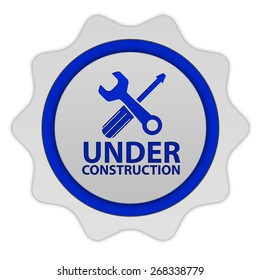 Under construction circular icon on white background
