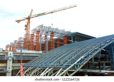 Under construction of metal steel framework outdoors buildings with crane.