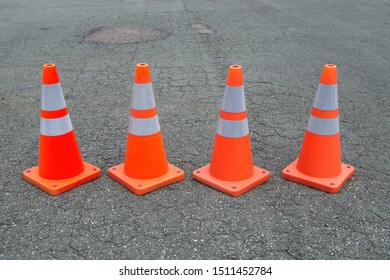 under construction orange traffic cones asphalt road web site