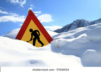 Under construction sign on snow