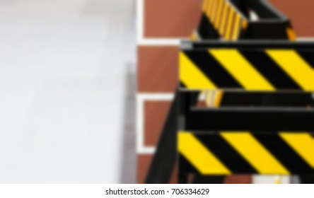 Under construction sign yellow with stripes.Yellow with black police line and danger tapes
