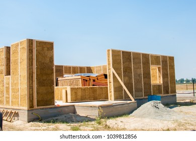 under construction of a straw house, in the summer under the sun