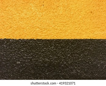 Under construction yellow and black paint wall background