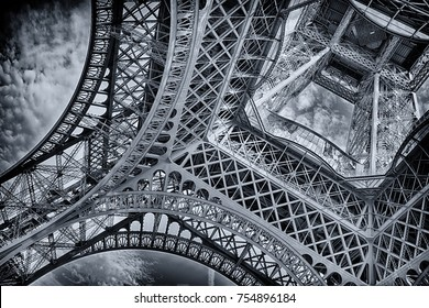 under the eiffel tower in black and white