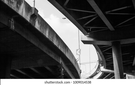 Under expressway, Curved bridge and arrow sign, Background Bangkok Thailand