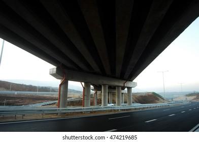 Under a highway bridge