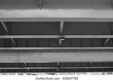 Under inside bridge steel . black and white color