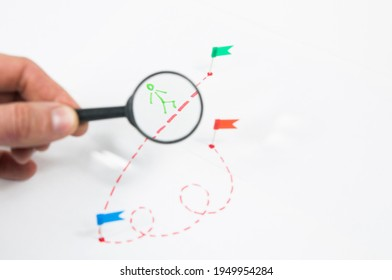 under a magnifying glass, consider a route with a painted little man with flags on a white background